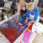 Hazel and Carol, working together on a painting.