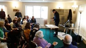 artist roger jenkins giving a watercolour demonstration to the sefton art group at highjtown, merseyside